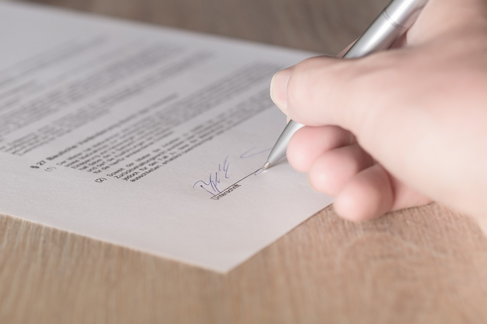 person signing land sale contract