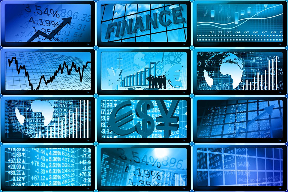 multiple screens showing foreign currency symbols and currency value graphs