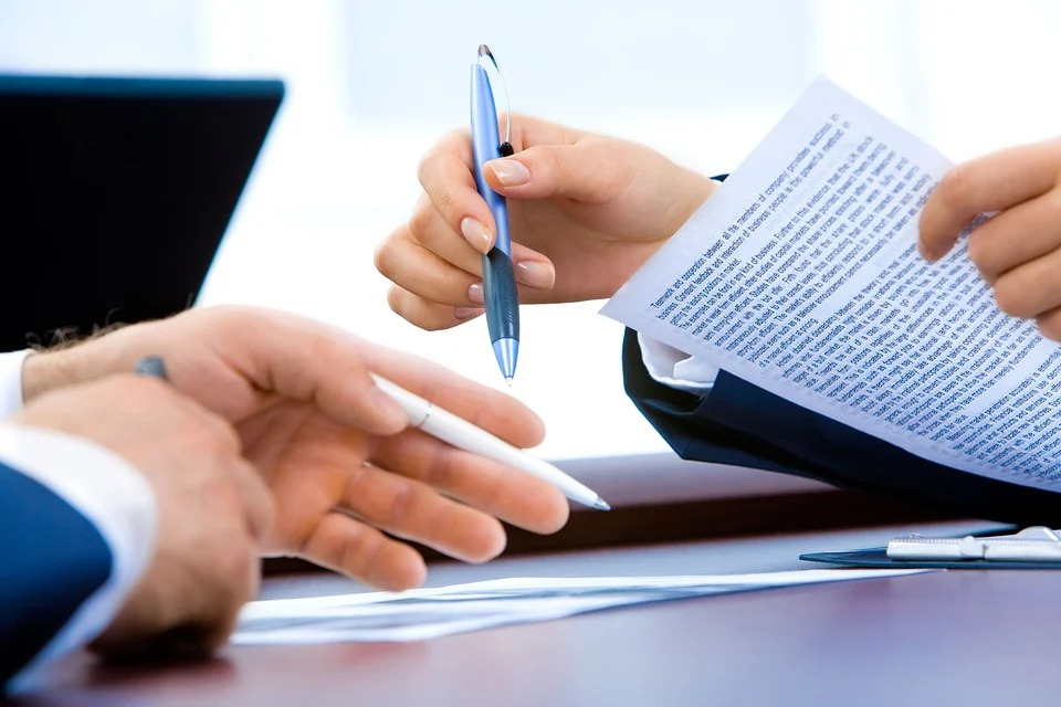 prospective buyer ad attorney reviewing real estate contract